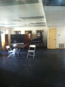 entertainment room for movie nights, community meetings, games, and smoking area